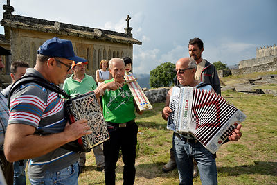 Musicians playing traditional music during the Rye Harvest Festival. Lindoso, Peneda Geres National Park. Alto Minho, Portugal