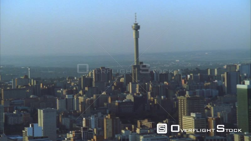 Aerial shot moving further away from the Johannesburg Central Business District at sunset/sunrise. Johannesburg Gauteng South Africa