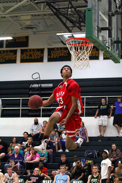 Iowa CIty High's Jerel Moore participates in the slam dunk competition. The Northern All-Star team defeated the Southern All-Star team 73-70 Wednesday night in Iowa CIty. (Justin Torner/Freelance)