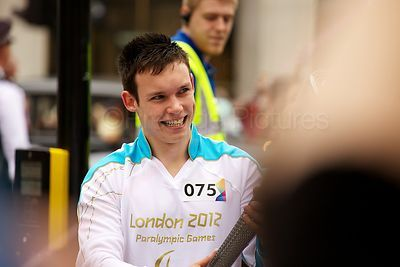 Excited Young Male Torch Bearer