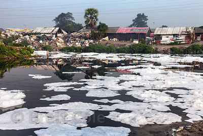 Foamy, dirty water in an unnamed creek near Bantala and Dhapa, Kolkata, India. The area is home to the main landfill for Kolkata, and a large number of small recycling operations, as well as leather incinerators. Pollution in the area is extreme.