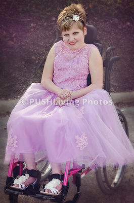 Teenage girl using a wheelchair all dressed up for the prom