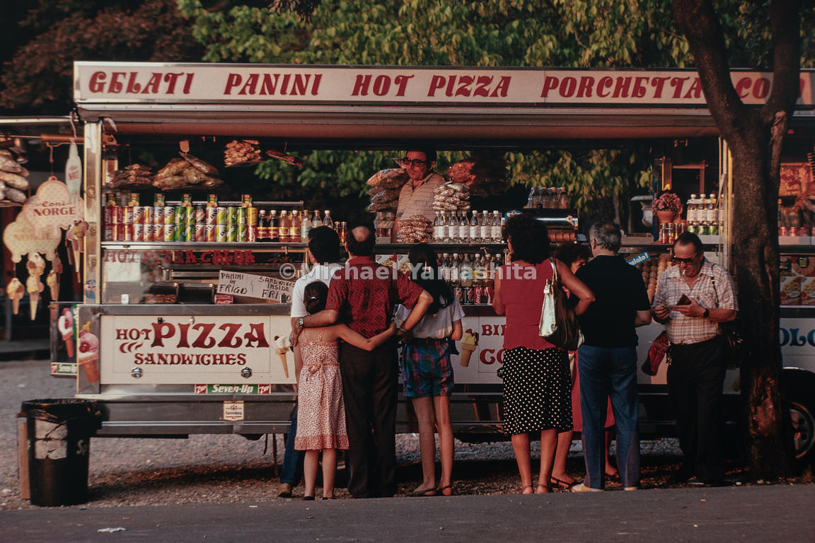 Consumers have a variety of options at a food stand in Villa Borghese. Rome, Italy, 1988.