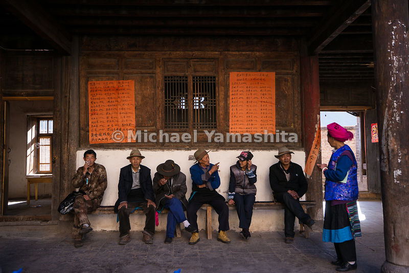 Residents catch up on news in Cizhong, a village known for its mix of Tibetan and French cultures. French missionaries built a church here in the early 1900s, and many of today's villagers are practicing Catholics.
