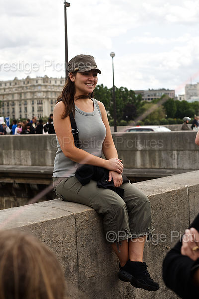 Pretty Young Woman Sitting on a Bridge over The Rover Seine