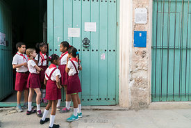 Young children going into school in the Old City, Havana, Cuba.