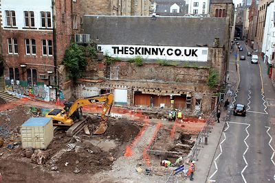 CAT Digger Working on the Site where the Cowgate Fire took Place in 2002 Alongside Archaeologists - 2012