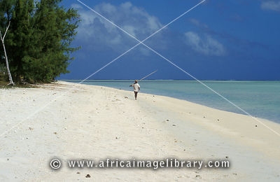 Fisherman walking on the beach, Ile aux Cocos, Rodrigues
