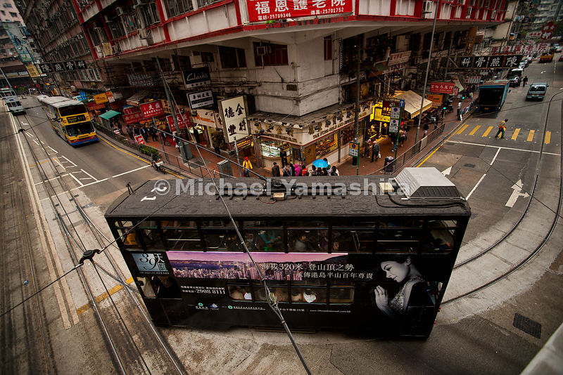 Hong Kong's Tramways, 118 trams, 6 lines, 30km, carries 240,000 passengers per day. Running since 1904. Operates from 5:30am till 12:30 am, speeds up to 60km, $2.00 per ride of any length make it HK's best travel bargain. Pics of North point