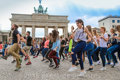 Large Dance Group performing by The Brandenburg Gate