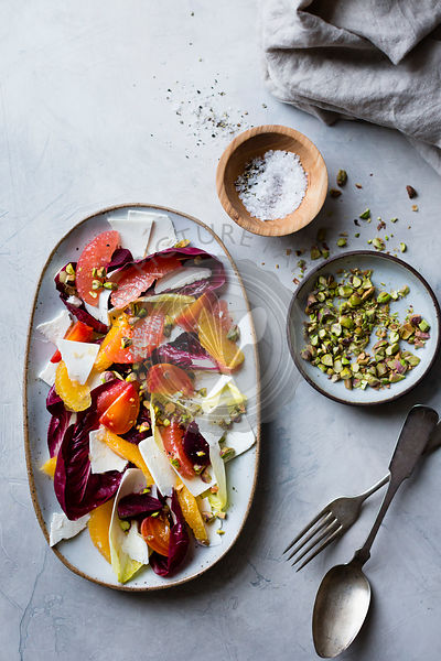 Citrus fruit and chicory ricotta salata with pistachios