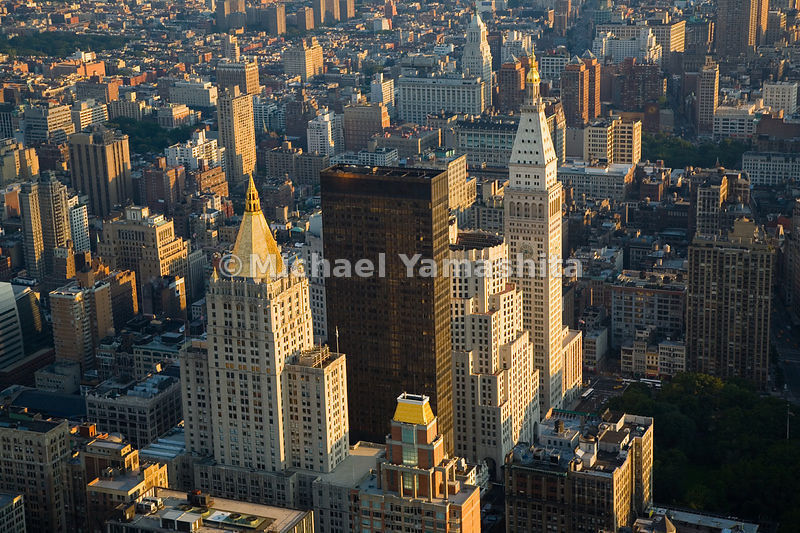 The gold-spired New York Life Building and the clocktower of the Metropolitan Life Insurance Building, modeled after the campanile at St. Mark's Square in Venice, both overlook Madison Square Park.  Manhattan, New York City.