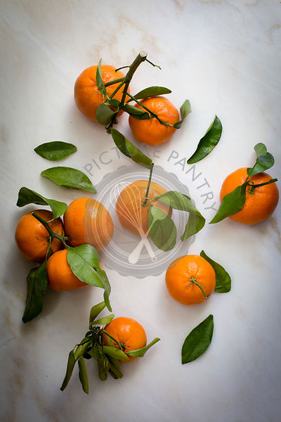 Tangerines with leaves and stem