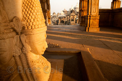 Early morning sun on marble statues at the Ahar Royal Cenotaphs, Udaipur, Rajasthan, India