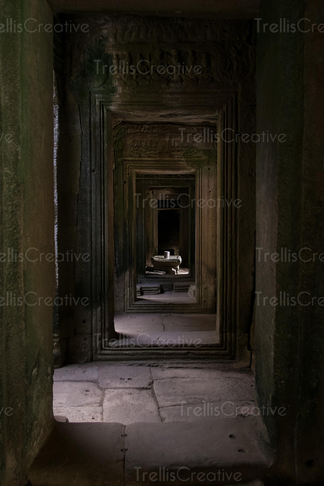 A hallway of doorways in a temple of Angkor Wat, Cambodia