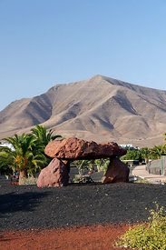 Hacha Grande and the mountains of Femes from Los Coloradas, Playa Blanca, Lanzarote, Canary Islands, Spain.