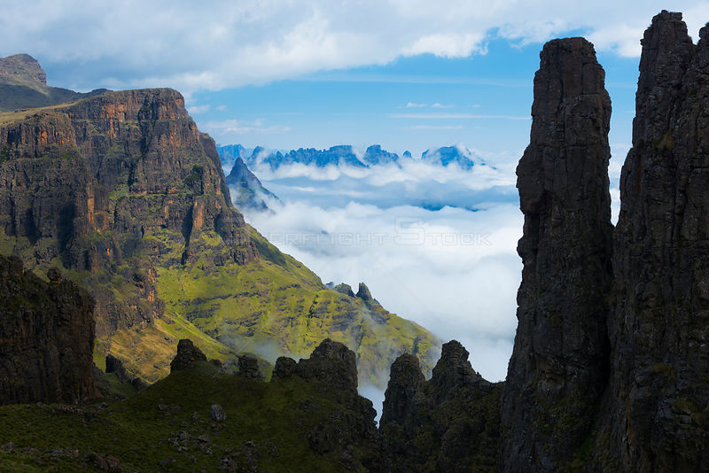 Misty morning in the Drakensberg viewed from behind the Organ Pipes. Cathedral Peak Region, Drakensberg, South Africa. November 2012.