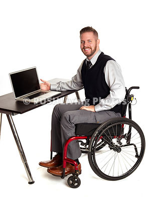 Business man in a wheelchair using his laptop