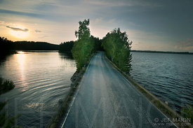 Road between lakes