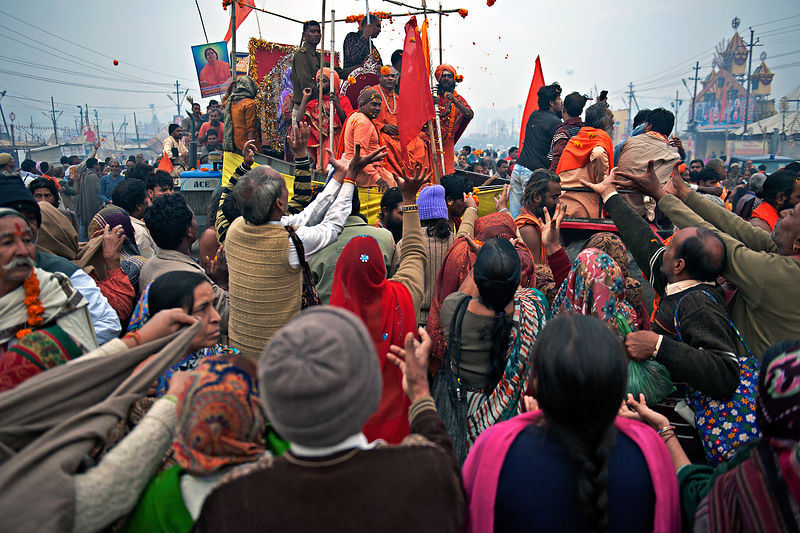 This photograph of the pilgrims trying to get the blessings from the saints was taken during the Kumbh mela, Allahabad.