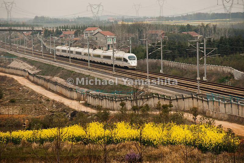 Guangzhou to Wuhan high speed bullet train capable of speeds up to 380km/hr. operating since January, 2010 Does the trip in 3hrs, 16min. 78million passengers/year. Normal trains take 12hrs. Technology from Siemens, Germany. Pics enroute to Guangzhou