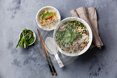 Pho Bo vietnamese Soup with beef on concrete background