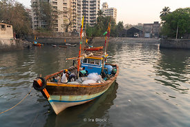 A boat near Sassoon dock, one of the largest fish markets in Mumbai, India