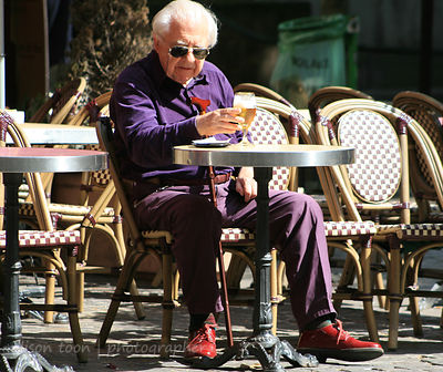 Gentleman sitting at a cafe in Paris, France