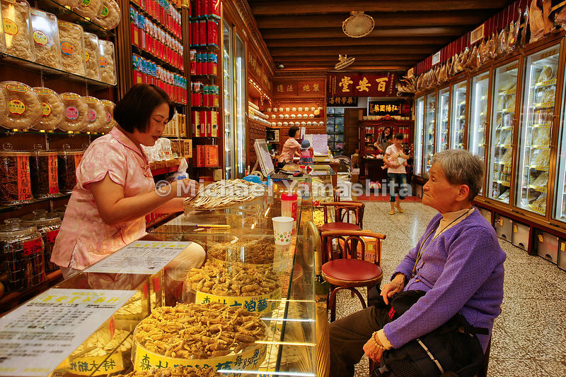 Chinatow, traffic, traditional medicine shops.