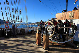 At the helm of the four masted barque Sedov, Tromso, Norway