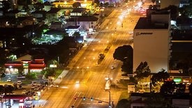 Wide Moving Shot of a Vibrant Sepulveda Blvd. Under LAX's 13 Pillars