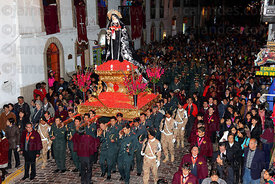 The red colour on the base are ñucchu flowers, which are common in the Cusco region which flower around Easter time. They are said to represent the blood of Christ, during Easter they are thrown over the dead body of Jesus, saints, crucifixes etc.