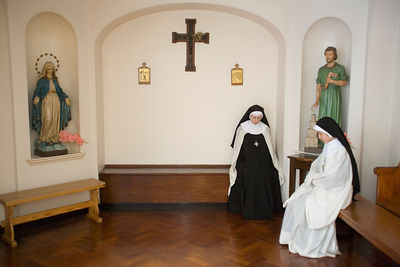 Nuns quietly waiting to process into service