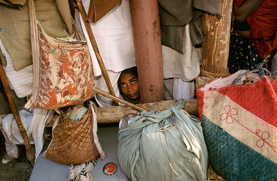 India - Allahbad - A pilgrim peers out of her tent, Ardh Kumbh Mela 1995, Allahbad, India