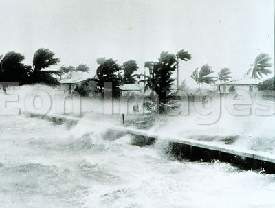 Waves threaten homes in Miami, 1945