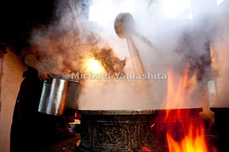 Shechen Monastery Tea making for 400 monks. 3 times per month the monastery school makes yak butter tea and serves tsampa breakfast for the students. pics of making. serving and eating.....................................