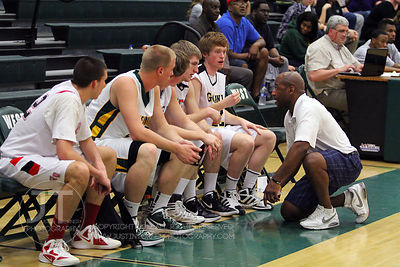 Northern Coach Carlos Nelson directs his bench players during the first half of play. The Northern All-Star team defeated the Southern All-Star team 73-70 Wednesday night in Iowa CIty. (Justin Torner/Freelance)