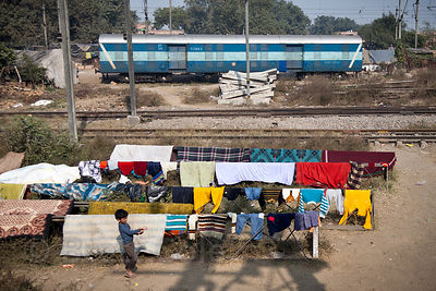 Laundry drying along railroad tracks near the Delhi Cantt station, Delhi, India