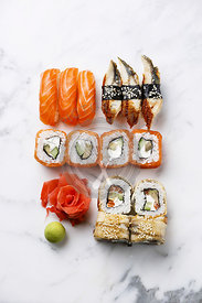 Sushi Set nigiri and sushi rolls on white marble background