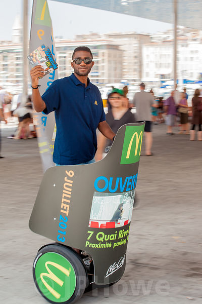 McDonalds worker Leafletting in MArseilles Harbour using a Segway Transporter