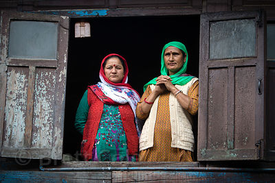 Ladies watch the Dussehra festival from a window in Kullu, India