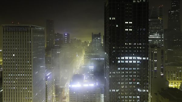 Bird's Eye: Creeping Fog Over High-Rises