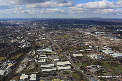 aerial photograph of Openshaw  East Manchester lookingtowards Beswick, West Gorton and the city centre   along Ashton Old Road, Manchester M11 2NA