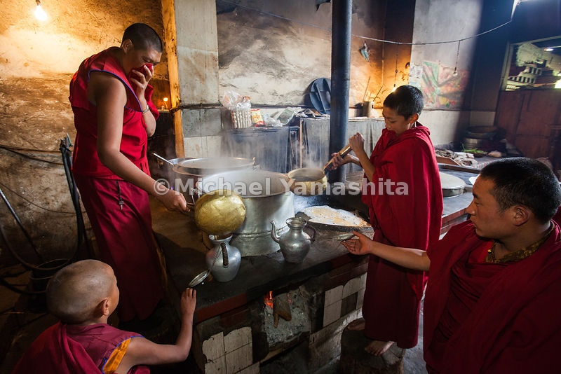 Ganze Monastery kitchen. Cooks prepare breakfast, rice and yak butter tea for 470 monks. 29 years ago there were over 1000. 800 left for India and have not returned.