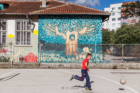 A young boy playing soccer by himself in Varna, Bulgaria.