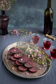 Marzipan Hibiscus Cups served on a copper tray.
