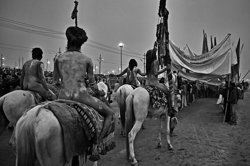 This photograph was taken during the Naga sadhus procession while the crowd looks on