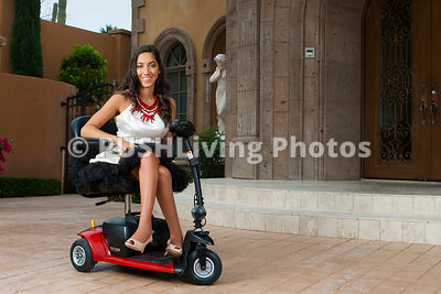 Young fashion model using a mobility scooter on a shoot