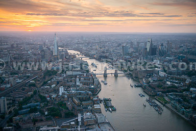 Aerial view looking West along the River Thames at dusk, London