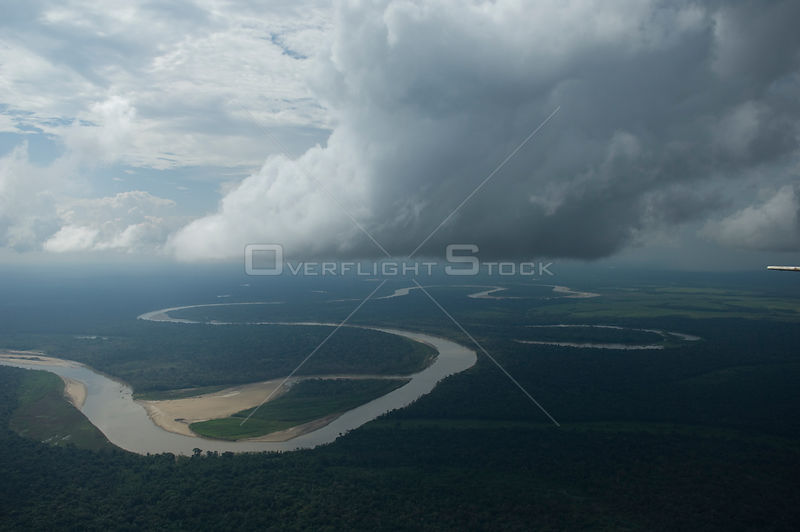 Aerial view of the Ichilo River and the rainforest (Amazon Basin) with storm clouds overhead, Santa Cruz Department, Eastern Bolivia.